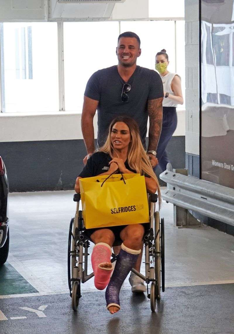 Katie Price AKA Jordan pictured with her boyfriend Carl Woods as he treats her to a shopping trip to Selfridges in London