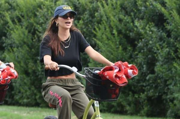 Emily Ratajkowski rides her bike to the beach with friends in the Hamptons New York