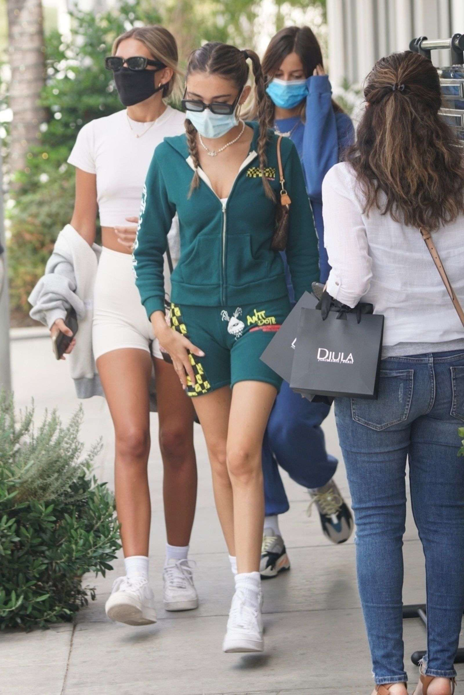 Madison Beer puts on a leggy display for a lunch outing with friends in Beverly Hills California