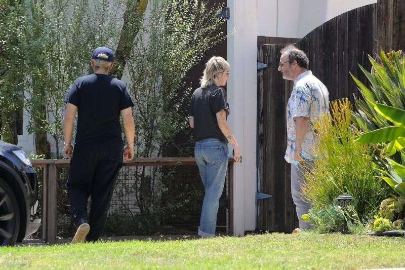Singer Miley Cyrus visits a friend's house in Calabasas California