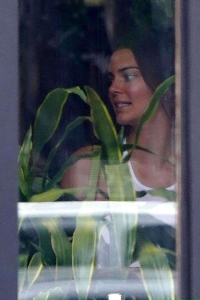 Top Model Kendall Jenner shows off her abs as she has drinks in West Hollywood California