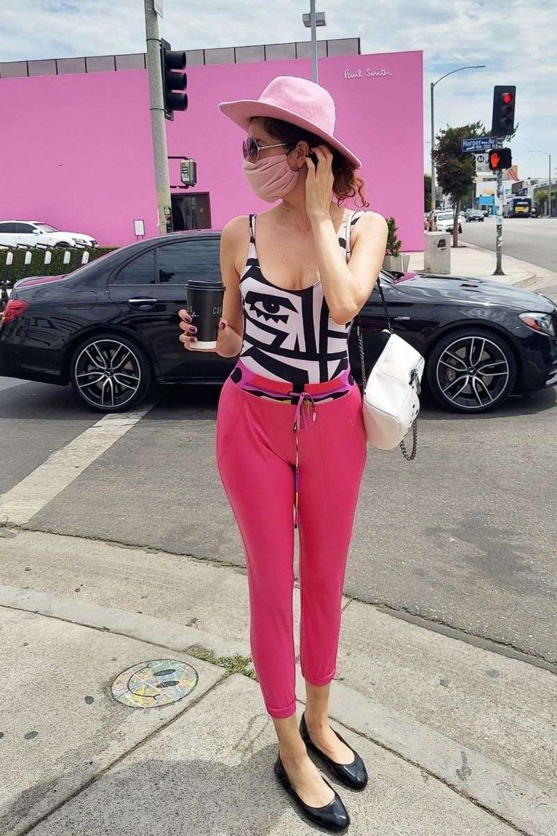 Blanca Blanco grabs some coffee while out for at stroll on Melrose