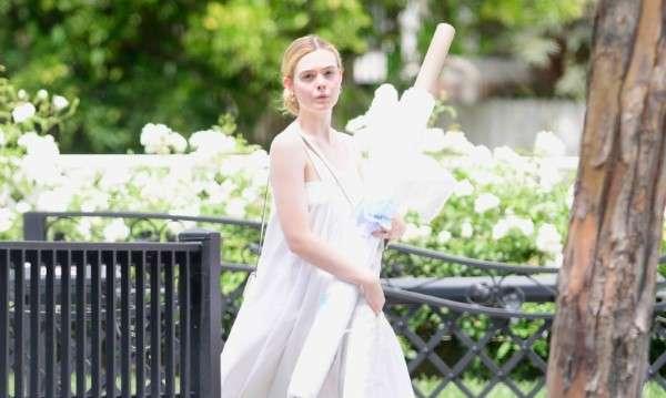 Elle Fanning wears a flowing white dress on a triple digit day in Los Angeles