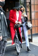 Miley Cyrus Hot Photos in a red trench coat paired with black leather pants and a black hat in New York 3