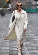Pretty Amanda Holden Looks chic and stylish in a cream dress and coat outside the Global Studios in London