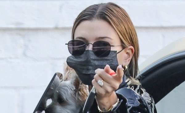 Hailey Bieber stops by a studio with her dog ahead of a photoshoot in Los Angeles California