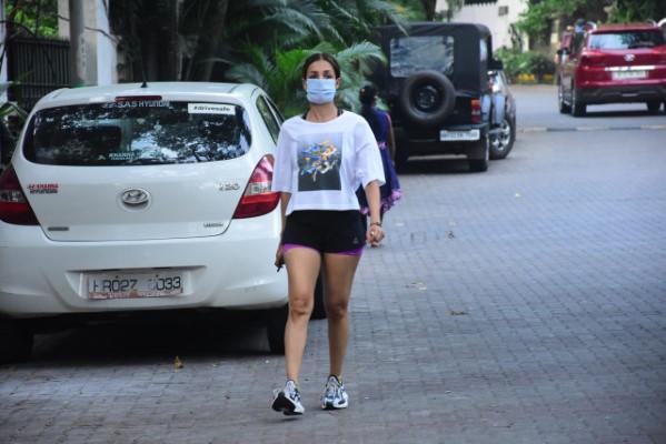 Malaika Arora Hot Photos In Black Short and White T shirt At Bandra