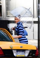 Bella Hadid puts in work as she poses on the set of the Michael Kors photoshoot in New York 13