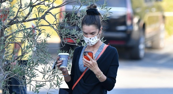Alessandra Ambrosio chats on her phone as she takes her kids out for ice cream