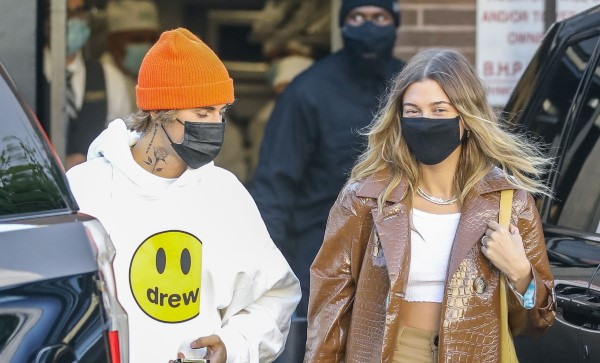 Justin and Hailey Bieber are spotted departing from the back exit