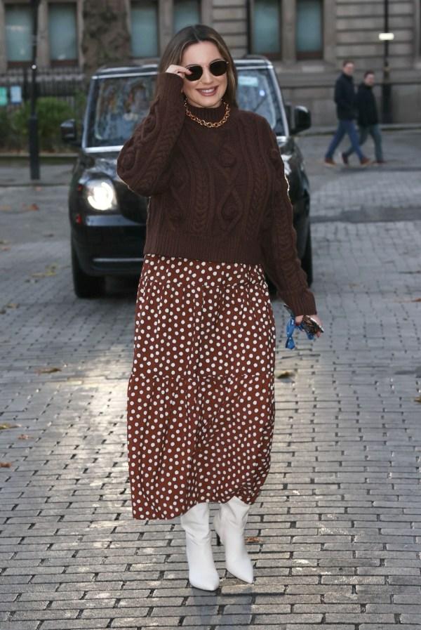 Kelly Brook Wears a polka dot skirt as she arrives at the Heart Radio