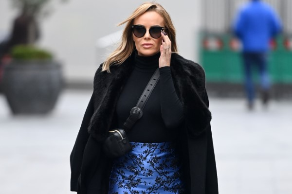 Amanda Holden Looks stylish wearing a blue mini skirt