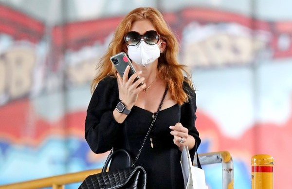 Isla Fisher Is spotted running errands in a slitted black dress