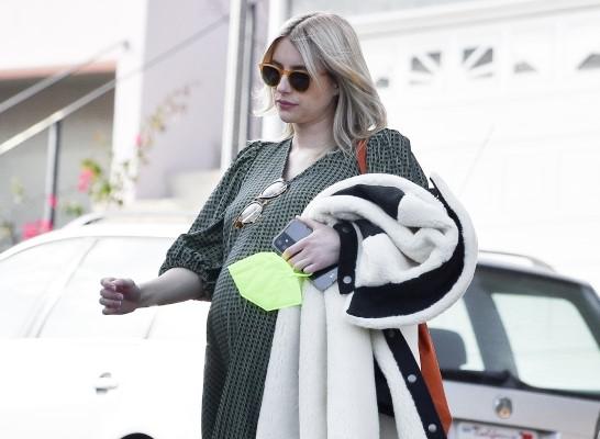 Emma Roberts Looks stylish in a green midi dress