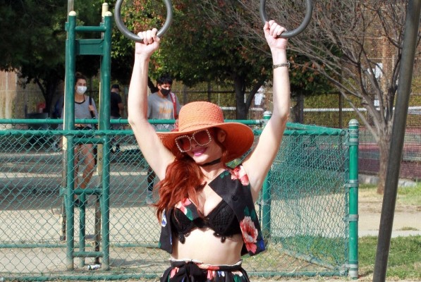 Phoebe Price Seen posing and working out