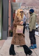 Rachel Zoe Steps out in her signature cheetah print coat and mask for a bit of shopping in downtown Aspe