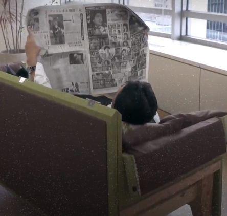 An employee lies on the coffin sofa
