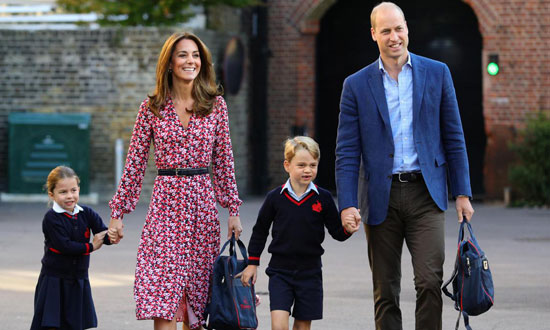 Prince William, his wife, Kate, Princess Charlotte, and Prince George