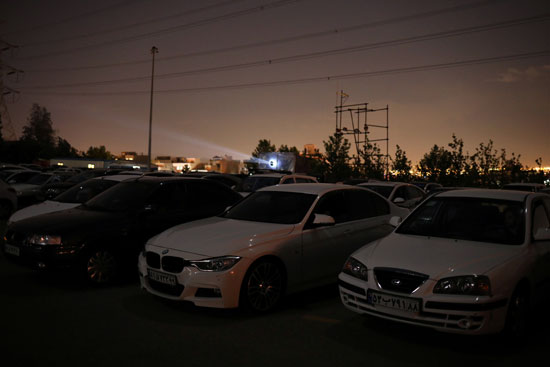 Cars lining up while watching a movie
