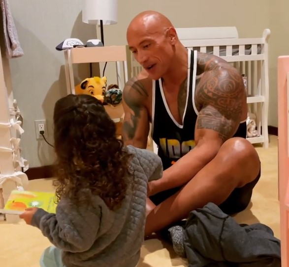 Dwayne Johnson plays with his daughter