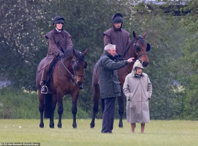Queen Elizabeth inspects the horses