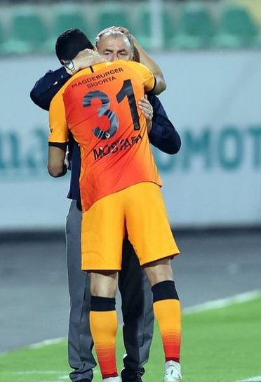 Mustafa Mohamed and his coach