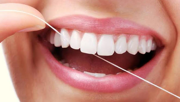 Brush your teeth with floss