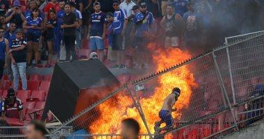 جماهير تشيلي تشعل النار بالاستاد الوطنى خلال مباراة بكأس