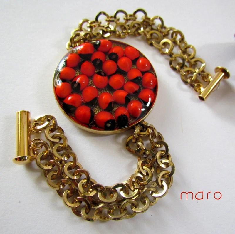 Red Seeds Bracelet. Resin - abrus precatorius - chain - bezel