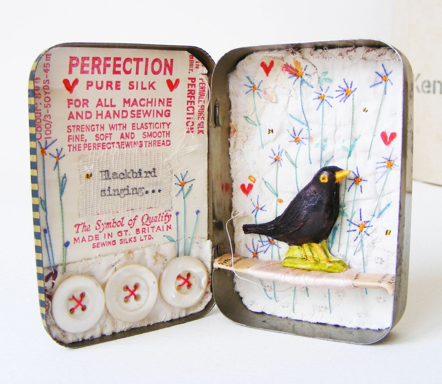 Free shipping . Vintage tin.  Artwork.   Blackbird singing.