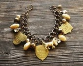 Vintage Celluloid Dog Charm Bracelet in Bronze and Butterscotch - Vintage Assemblage