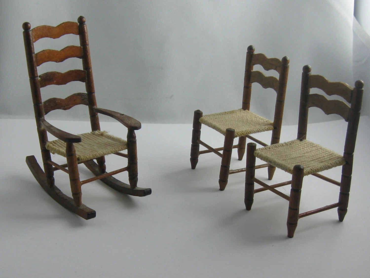 Miniature dollhouse furniture: a rocking chair and 2 chairs made of ...