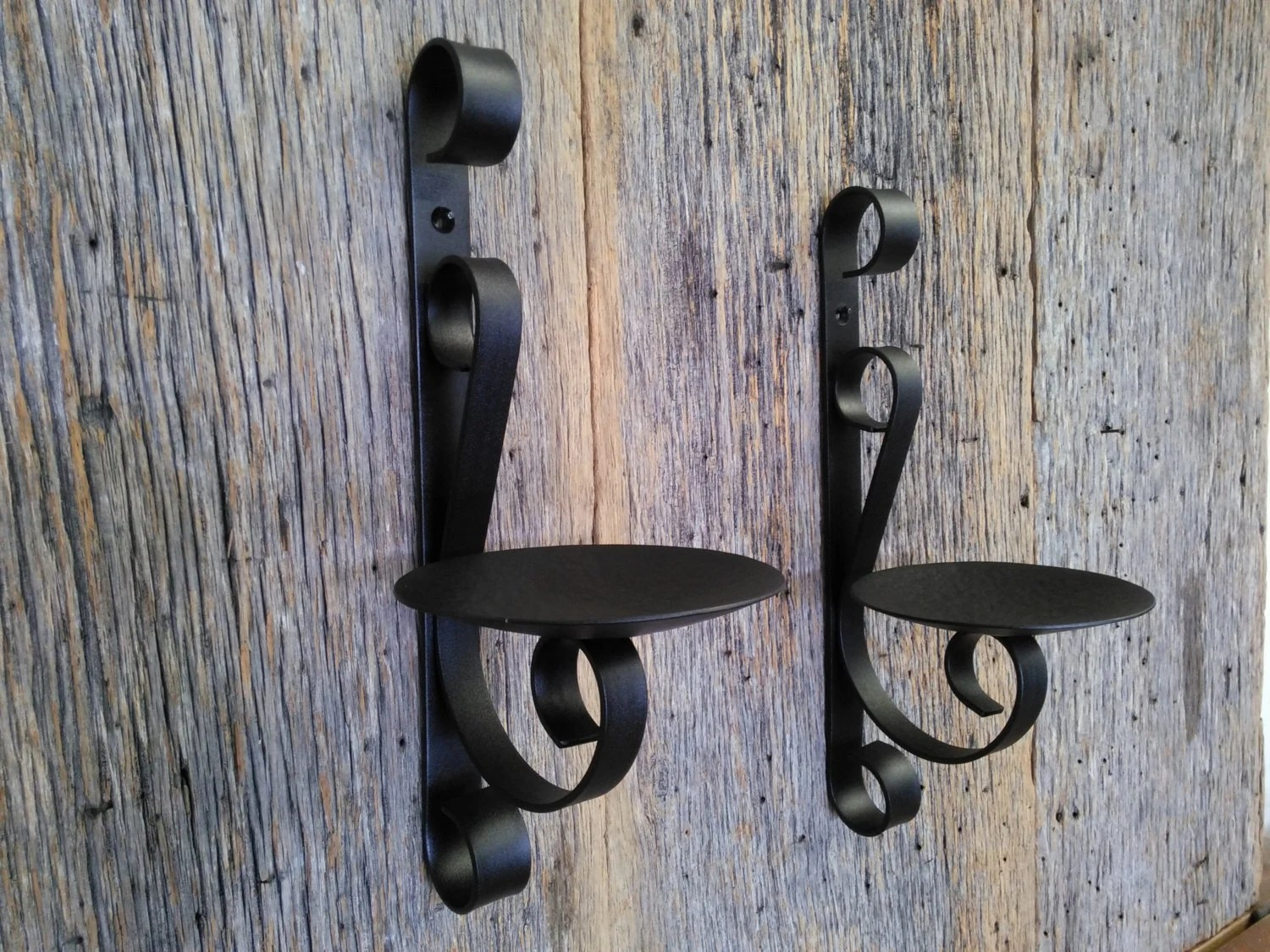 Two metal candle holders rustic black wrought iron wall sconce on Black Wrought Iron Wall Candle Holders id=82273