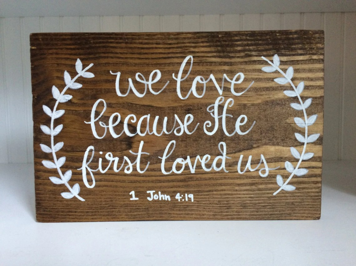 Download We Love Because He First Loved Us // wooden calligraphy sign