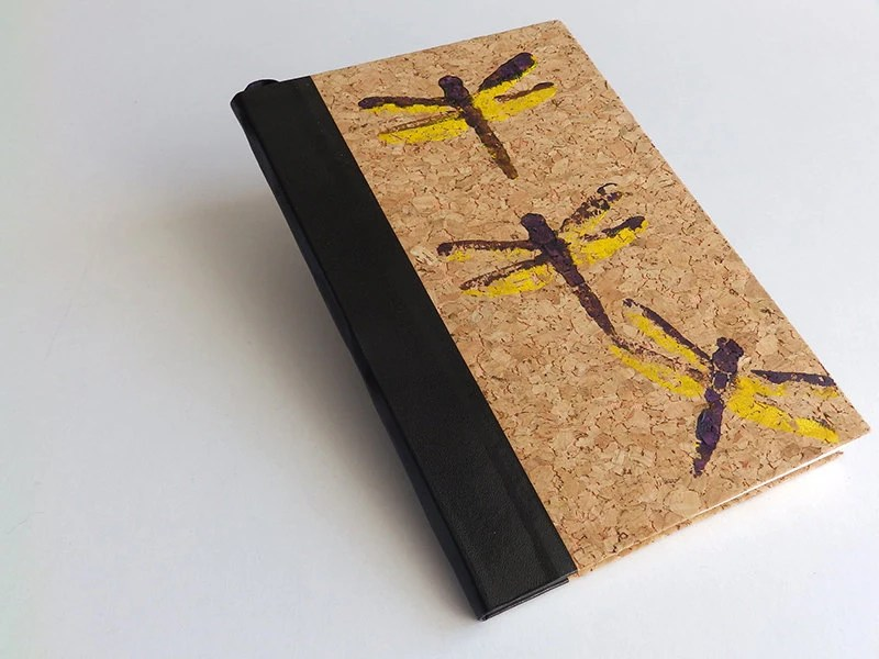 Artistic sketchbook with dragonflies