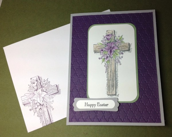 Easter greeting card featuring a cross and purple flowers by