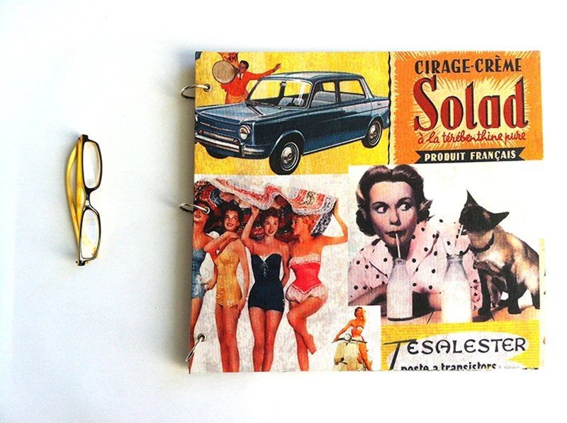 Photographic album with vintage ads