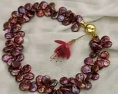 Pearls in fuchsia colour - enormous effect