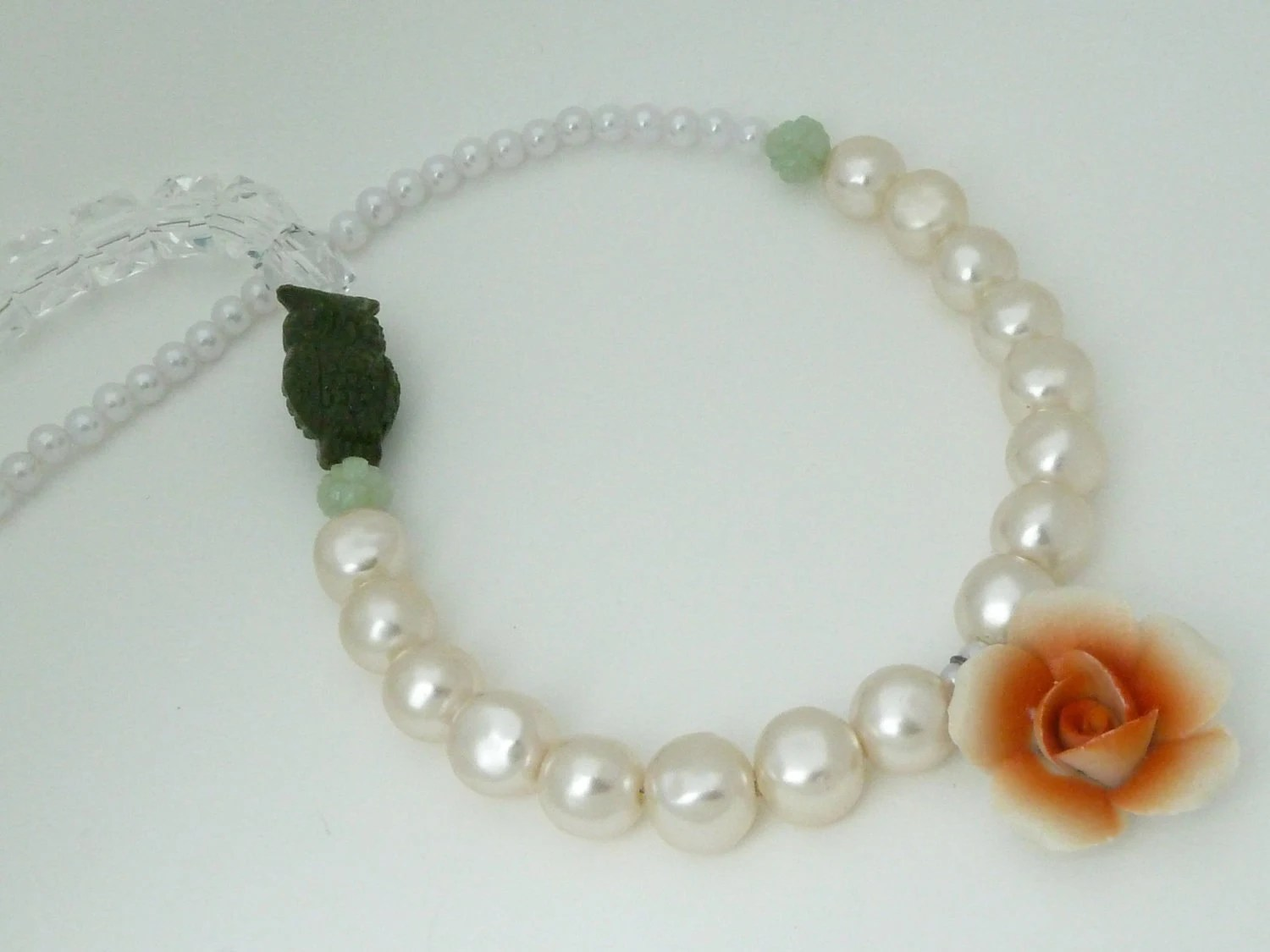 pearl, crystal, owl, and flower necklace