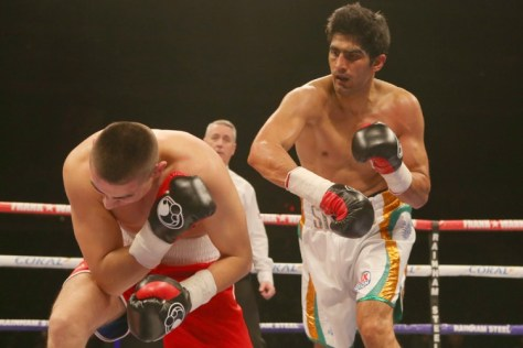Unlike his first three bouts, when his opponents looked in a hurry to wind up bouts as soon as possible, Indian ace boxer Vijender Singhs Hungarian opponent Alexander Horvath during the Manchester bout appeared a bit relaxed and in a mood to put up fight for some time. However, all his efforts of staying in the ring for comparatively longer time came to naught as the end result was same  Vijender knocked out the Hungarian to register his fourth victory in succession. Alexander, who was dining on viper's blood in build-up to the bout, looked less venomous against Vijender, who executed his calculated punches smartly and knocked out his opponent in the third round itself. (Getty Images)
