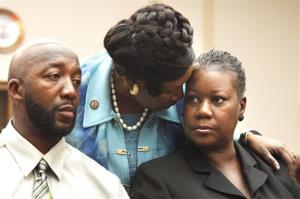 Rep. Sheila Jackson Lee, D-Texas, center, greets Trayvon Martin's parents, Tracy Martin, left, and Sybrina Fulton.