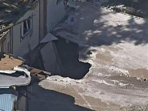 This video image provided by ABC Action News-WFTS TV, shows an aerial photo of the sinkhole that swallowed Jeffrey Bush in Seffner, Fla.
