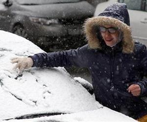 A Syrian youth draws a heart in the snow on a car in Damascus, Syria, Dec. 13, 2013 as a blustery storm, dubbed Alexa, brought gusty winds, torrential rains and heavy snowfall to the Middle East.