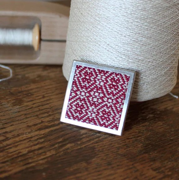 Handwoven fabric brooch. Cranberry red and white twill in square silver tone setting handmade by Nutfield Weaver.