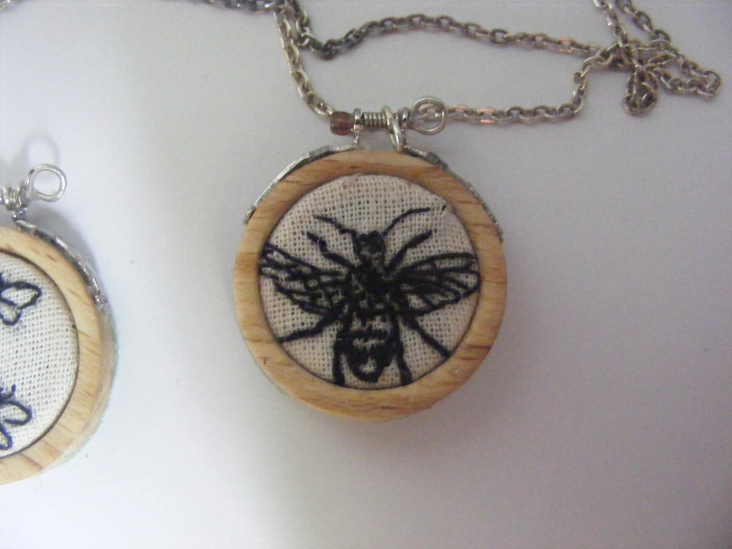 Mini embroidery hoop necklace .Hand turned beech rings with pretty  bee embroidery.
