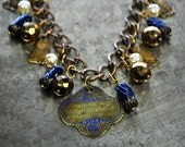 Cat Jewelry Charm Bracelet with Vintage Rival Cat Food Tag - Vintage Assemblage
