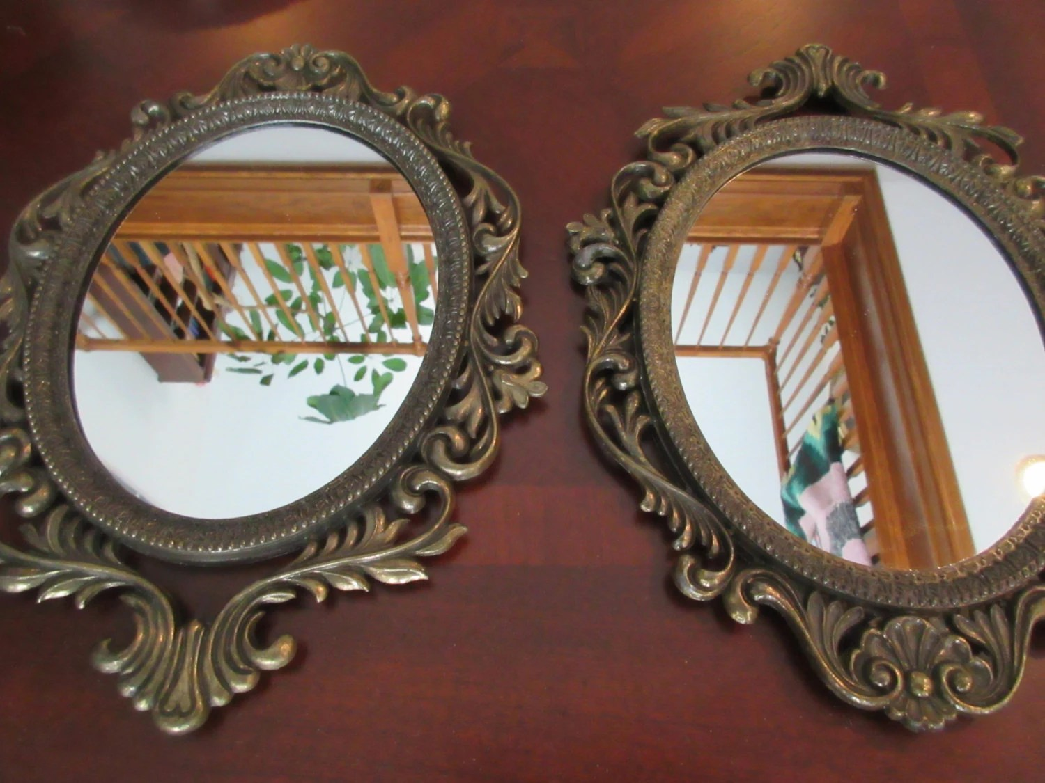Oval Hanging Wall Mirrors. Two Metal Frame Hanging Mirrors