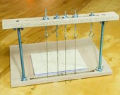 Sewing Frame With Hooks for Cord Adjustment