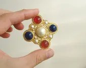 Costume jewelry brooch in...