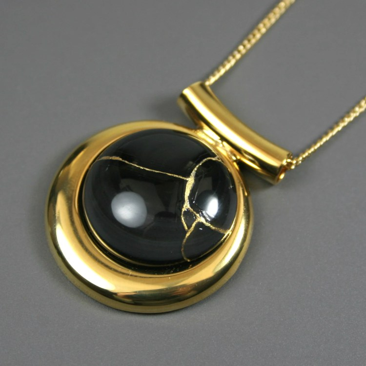 Kintsugi (kintsukuroi) black onyx stone pendant with gold repair in a gold plated setting on gold chain - OOAK